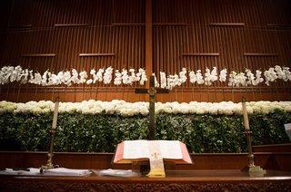 orchid-spray-hydrangea-english-ivy-smilax-decorating-church-altar-at-wedding