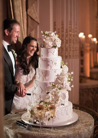 wedding-reception-cake-ron-ben-israel-lace-design-sugar-flowers-cascading-down-with-topper