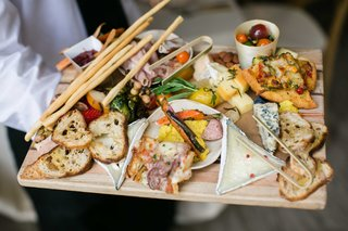 crostini-board-with-artisan-meat-fresh-cheese-slices-olive-flatbread-olive-oil-dips-vegetables
