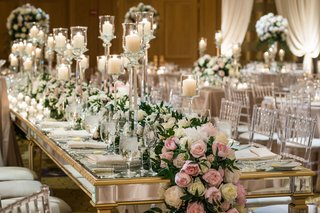 wedding-reception-long-gold-mirror-table-with-candles-and-flower-runner-greenery-pink-white-flowers