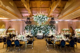 george-springer-astros-wedding-ballroom-black-gold-chairs-flower-wall-and-flower-chandelier