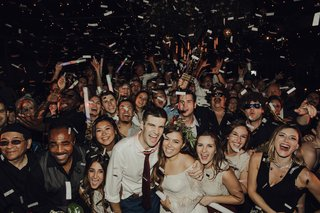 wedding-guests-at-wedding-reception-confetti-after-party-happy-friends-and-family