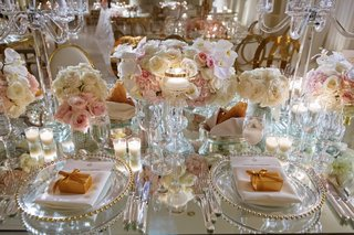 mirror-wedding-reception-table-gold-beaded-charger-plate-godiva-chocolate-favors-floating-candles