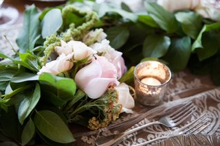 a-verdant-table-runner-featuring-greenery-and-pink-flowers-rose