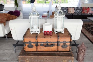 tented-wedding-cocktail-hour-with-antique-wood-trunks-and-lanterns