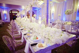 silver-sequin-head-table-with-lush-floral-centerpieces