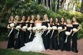 large-group-of-bridesmaids-in-black-off-the-shoulder-katie-may-gown-bride-in-gemma-vera-wang