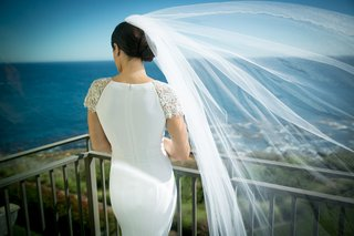 back-of-bride-flowing-veil-pacific-ocean-california-wedding-epic-beautiful-shot-wind