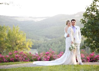 bride-in-marchesa-wedding-dress-long-sleeves-v-back-mermaid-groom-in-white-tuxedo-tuscany-road