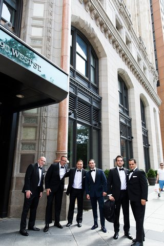 groom-and-groomsmen-in-new-york-city-in-tuxedos-in-front-of-hotel-city-wedding