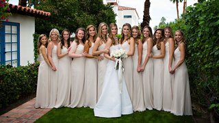 bride-in-white-a-line-wedding-dress-and-bridesmaids-in-ivory-beige-floor-length-dresses-white-flower
