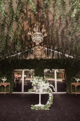 reception-tent-with-hanging-greenery-all-over-tented-area-and-tables