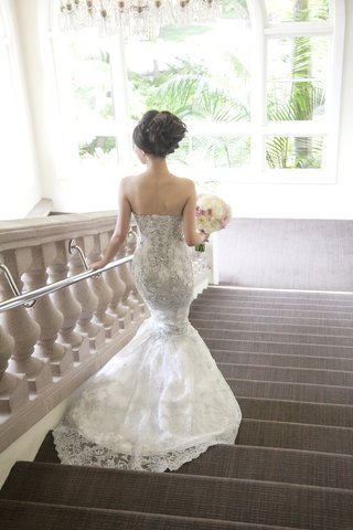 bride-walking-down-steps-in-silver-beading-mermaid-dress