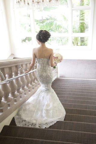bride-walking-down-steps-in-silver-beading-mermaid-dress