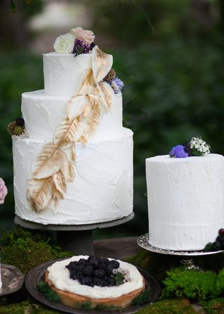 white-wedding-cake-with-golden-leaves-and-white-wedding-cake-with-wood-grain-etchings-flowers