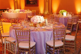 lavender-tablecloths-with-gold-chairs-and-gold-lighting