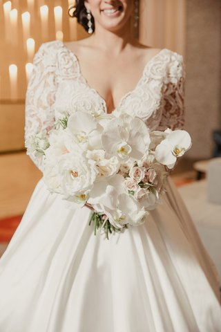 bride-in-v-neck-wedding-dress-with-rose-orchid-bouquet-pnina-tornai-ball-gown-dress
