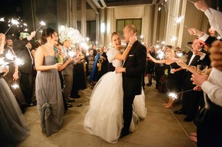 bride-in-vera-wang-wedding-dress-with-fur-shawl-at-sparkler-exit