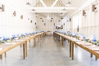 wedding-reception-lombardi-house-los-angeles-bright-blue-glassware-cool-lighting-wood-tables