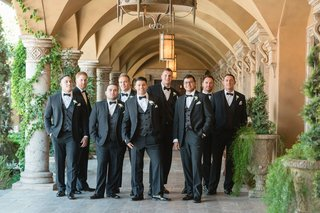 groom-in-tuxedo-and-bow-tie-with-groomsmen-in-matching-outfits-villa-venue-in-arizona-villa-siena