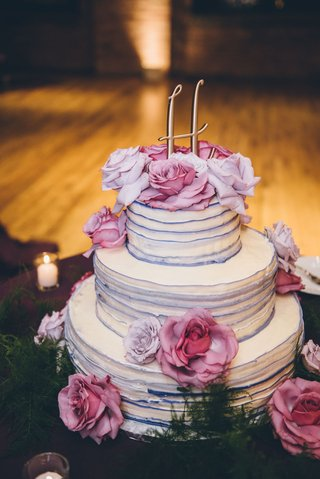 wedding-cake-three-layer-with-purple-edge-ruffles-and-gold-monogram-cake-topper-fresh-flowers-pink