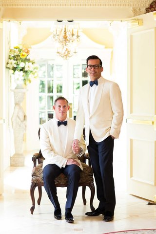 grooms-wear-white-tuxedo-jackets-and-bow-ties-portrait