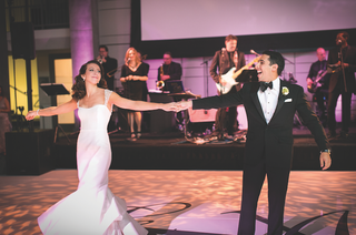 bride-and-groom-dancing-on-illuminated-dance-floor