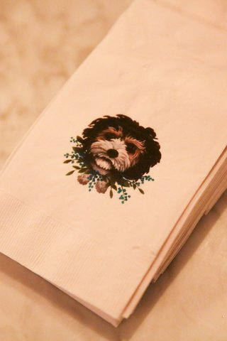 custom wedding details illustration of little dog on napkin with blue delphinium flower collar