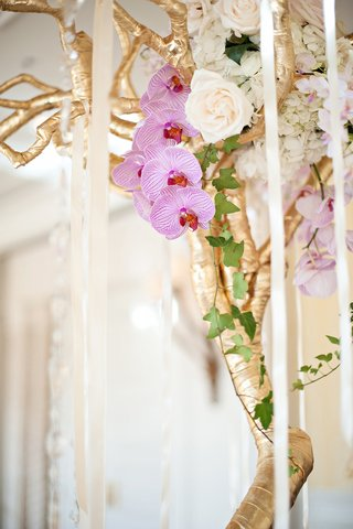 gilt-branches-tied-with-crystals-and-romantic-flowers