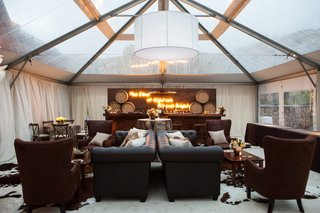 tented-area-for-large-wedding-mens-lounge-masculine-lounge-area-at-wedding