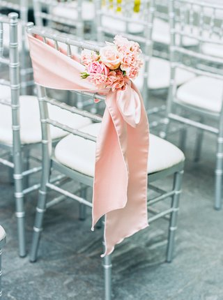 silver-gray-ceremony-chair-pink-silk-stain-fabric-small-cluster-of-pink-and-white-flowers