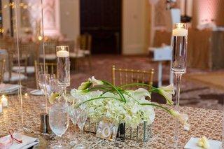 small-centerpiece-of-white-calla-lilies-and-hydrangeas-in-a-mirrored-box
