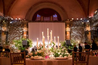 wedding-reception-sweetheart-table-facing-dance-floor-with-candelabra-taper-candles-gold-chairs