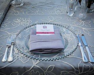 wedding-reception-silver-linens-with-flower-details-napkin-with-monogram-menu-card-burgundy-fall