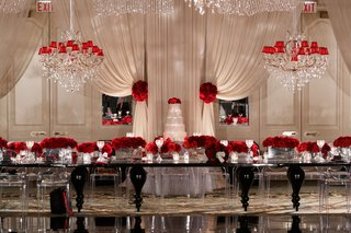 wedding-reception-white-drapery-chandelier-red-shade-black-modern-table-red-roses-low-centerpieces
