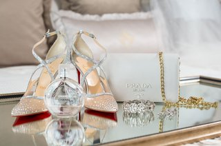 wedding-accessories-christian-louboutin-red-bottom-heels-mesh-jewels-chanel-perfume-prada-clutch