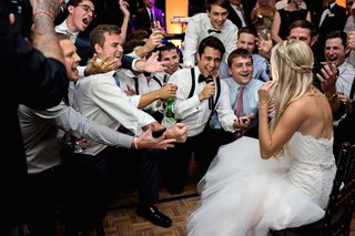 male-guests-sing-to-bride-in-a-romona-keveza-strapless-gown