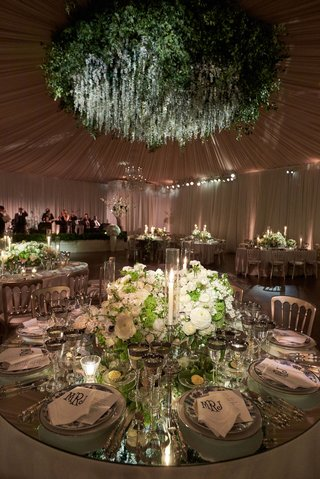 wedding-reception-flower-chandelier-round-mirror-table-low-centerpiece-candles-chinoiserie-plate