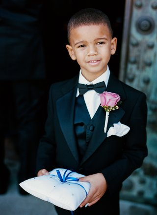 african-american-ring-bearer-in-tux-holding-blue-ring-pillow