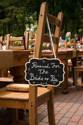reserved-die-cut-sign-hung-from-the-brides-chair