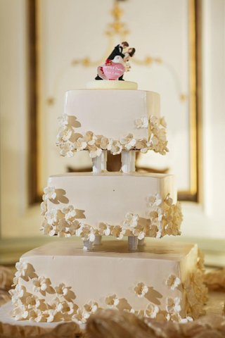 white-wedding-cake-with-square-tiers-and-small-white-sugar-flowers