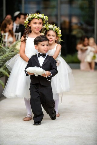 ring-bearer-holding-ring-pillow-in-tuxedo-and-flower-girls-behind-white-dresses-flower-crown-ballet
