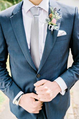 mens-blue-suit-wildflower-boutonniere-rose-greenery-blush-pink-silver-tie-british-english-wedding