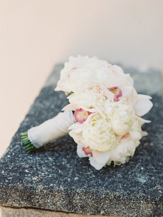 a-bridal-bouquet-of-white-garden-roses-and-peonies-and-pink-orchids