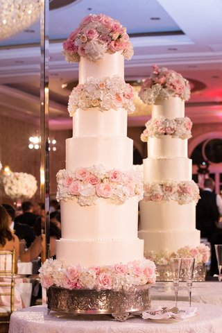 five-tiered-ivory-wedding-cake-with-blush-roses