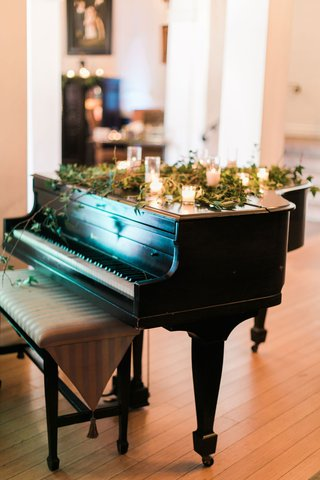wedding-ceremony-downtown-los-angeles-grand-piano-with-candles-and-greenery-on-top-decorations