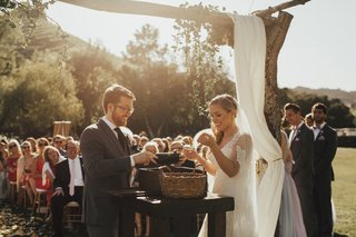 bride-and-groom-participating-in-wine-ceremony-at-wedding