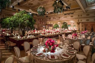 wedding-reception-for-700-guests-gatsby-garden-theme-green-hedge-pink-flowers-tree-centerpieces