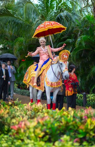 indian-groom-in-sherwani-on-horseback-for-baraat