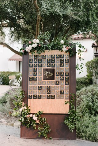 wooden-seating-chart-display-with-gold-wax-seals